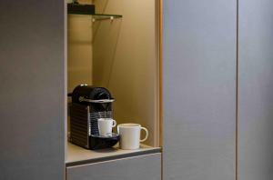 Kaffee-/Teezubehör in der Unterkunft OBERDECK Studio Apartments