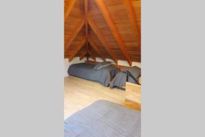 Una cama o camas en una habitación de Edificio Centenario San Martin de los Andes