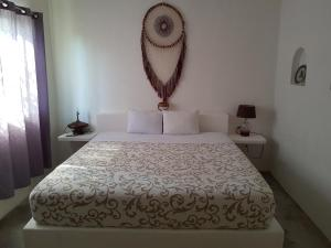 A bed or beds in a room at Loto Tulum