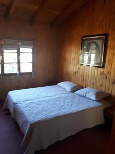 Una cama o camas en una habitación de Casa Pérez