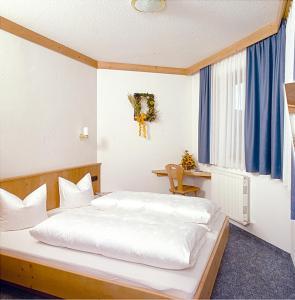 Ein Bett oder Betten in einem Zimmer der Unterkunft Appartement Zottl