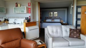 A seating area at Armalong Winery Chalets