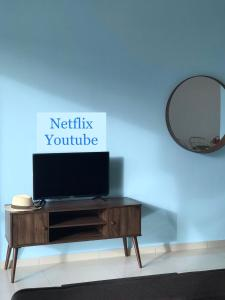 A television and/or entertainment centre at Santorini Residence Suites