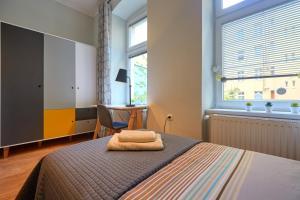 Łóżko lub łóżka w pokoju w obiekcie Piano Apartment