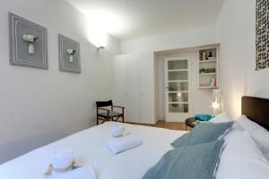 A bed or beds in a room at Costa San Giorgio 76