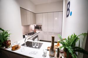 A kitchen or kitchenette at Resolution Suite: Practice Self-Care