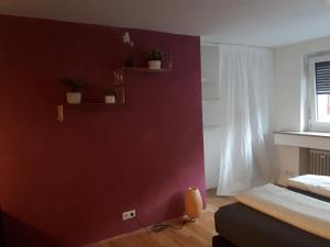 A bed or beds in a room at Central Apartment Nürnberg