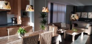 A seating area at Apartment Campinor
