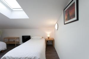 Un ou plusieurs lits dans un hébergement de l'établissement Gîte du Charme Provençal
