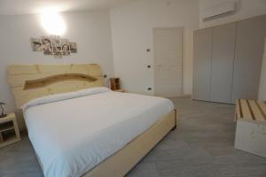 Letto o letti in una camera di LaBaitaCase SLEEP & BIKE