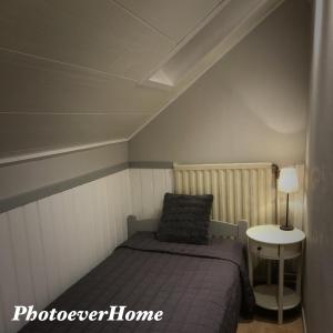 A bed or beds in a room at Photoeverhome