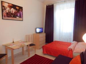 Télévision ou salle de divertissement dans l'établissement Apartments U Staropramenu