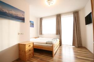 Ein Bett oder Betten in einem Zimmer der Unterkunft Haus Magdalena