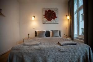 A bed or beds in a room at Daily Apartments- Central Riverside Residence