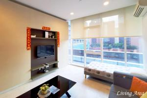A television and/or entertainment center at Luxury Homes Platinum Suites KLCC