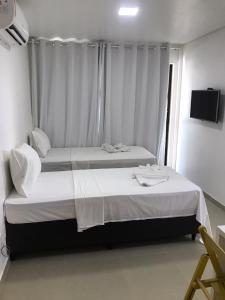 Cama ou camas em um quarto em Manawa Beach Flat by AFT