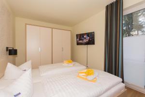 Postel nebo postele na pokoji v ubytování Apartmenthaus Kleiner Falke