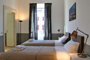 A bed or beds in a room at Da Sabrina Cavour 57