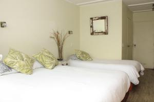 A bed or beds in a room at Riomar Apart Hotel