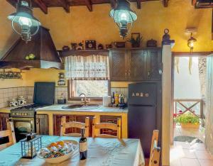 Ein Restaurant oder anderes Speiselokal in der Unterkunft Villa Masca
