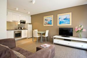 אזור ישיבה ב-Harbourside Apartments