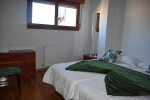 Un ou plusieurs lits dans un hébergement de l'établissement Apartamento Belmecher