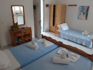 A bed or beds in a room at Fiore Di Mare Studios