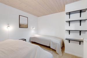 En eller flere senge i et værelse på Adventure Park Apartments