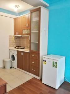 Кухня или мини-кухня в Naz 40 Aparthotel
