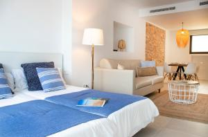 A bed or beds in a room at Gaviota - Formentera Vacaciones Adults Only
