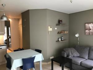 Coin salon dans l'établissement Appartement Koksijde