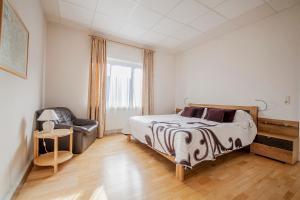 Ein Bett oder Betten in einem Zimmer der Unterkunft Haus Repin