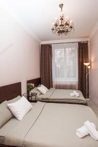 A bed or beds in a room at Kutuzovskiy Prospect 26 Apartment