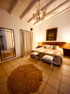 A bed or beds in a room at Casa de Huespedes Chañarmuyo
