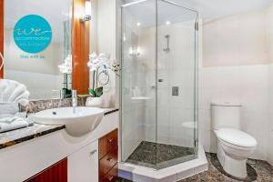 A bathroom at Chevron Renaissance Apartments and Sub Penthouses - We Accommodate