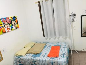 A bed or beds in a room at Studio Room Nogueira