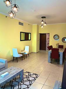 A restaurant or other place to eat at 2 Bedroom Downtown Holidays R Us