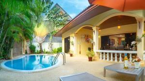 The swimming pool at or near Coconut Paradise Villas