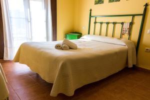 Cama o camas de una habitación en La Enrama del Cerrillo
