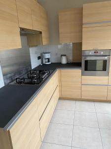 Een keuken of kitchenette bij Westhoek Apartments