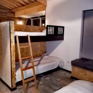 A bunk bed or bunk beds in a room at Bahia Serena