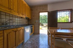 A kitchen or kitchenette at Cana Lali