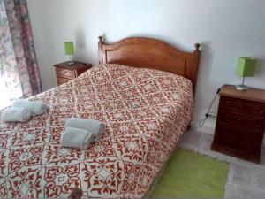 Uma cama ou camas num quarto em Apartamento Gago Coutinho