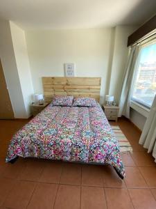 Una cama o camas en una habitación de Andino center