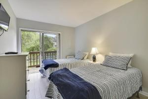 A bed or beds in a room at Baystrand III Unit 9 by Long & Foster