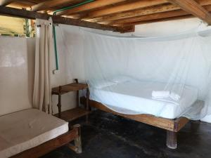 A bed or beds in a room at Dahlandia