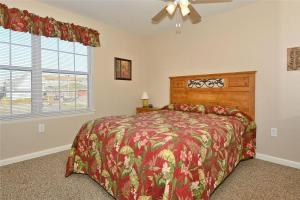 A bed or beds in a room at Rainbow Cove 105A Dagsworthy St. by Long & Foster