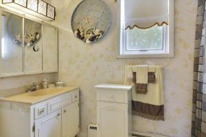 A bathroom at 39 Beach Avenue by Long & Foster