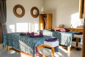 Krevet ili kreveti u jedinici u objektu Desa Pramana Swan
