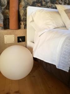 Letto o letti in una camera di Al Maratoneta